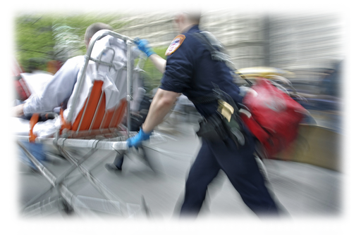 Paramedics helping a patient on a stretcher