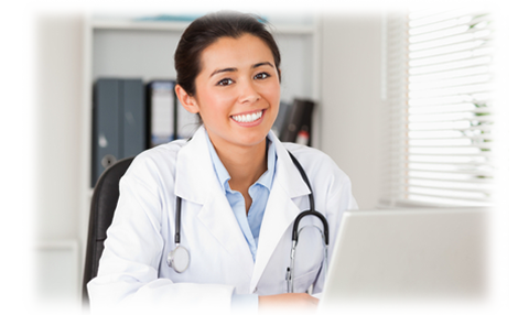 Doctor sitting at her computer