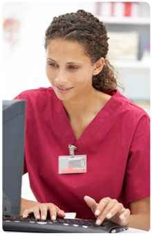 Nurse inputting data into computer