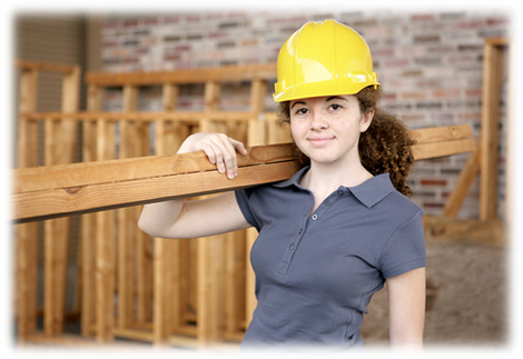 Woman wearing a hard hat holding plywood