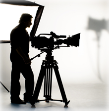 Silhouette of a man with a video camera